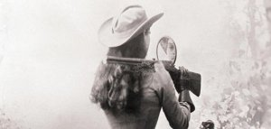 Shooting backwards with a mirror was one of Annie Oakley's most popular tricks.