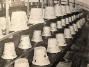 Tomato pails line up in a cannery in Federalsburg, Maryland