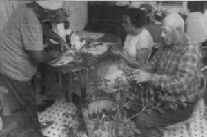 Norman Davis and Leuvenia Watson of Atlantic Va. Making Holly Wreath