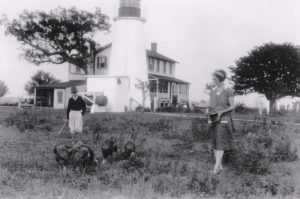 Fannie May Salter and son feeding turkeys in 1930s Credit Turkey Point Light