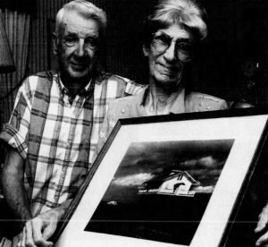 Vernon and Juanita Cooper Holding Photo of Great Shoals in 2002 Photo by Brice Stump The_Daily_Times